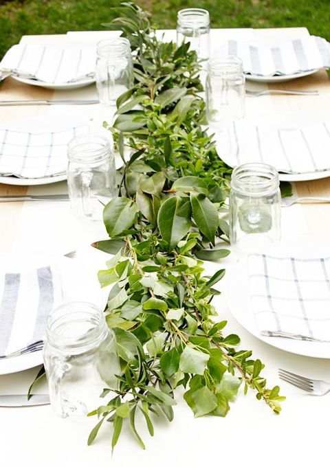 Breathtaking green and flower wedding table runners