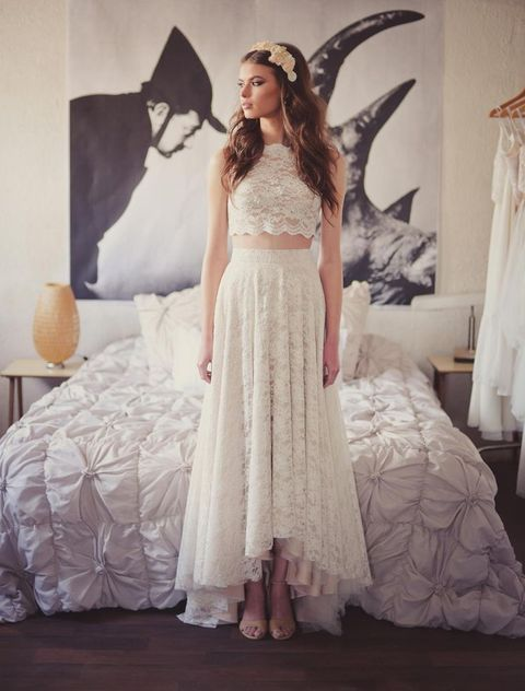 b154753ec This is a trendy bridal separate with a lace applique and bead crop top and  a high low skirt