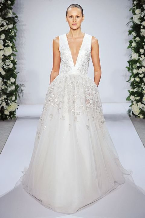 ball gown with floral appliques and a deep V plunging neckline