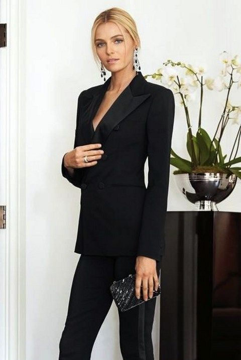 black pant suit with heels and a glitter clutch