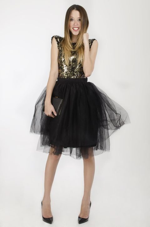 black tulle skirt, a gold sequin top and heels