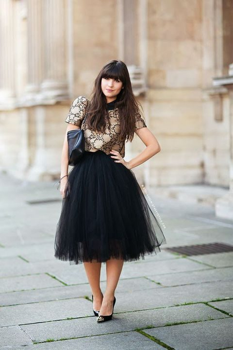 black tulle skirt, a nude and black top with short sleeves