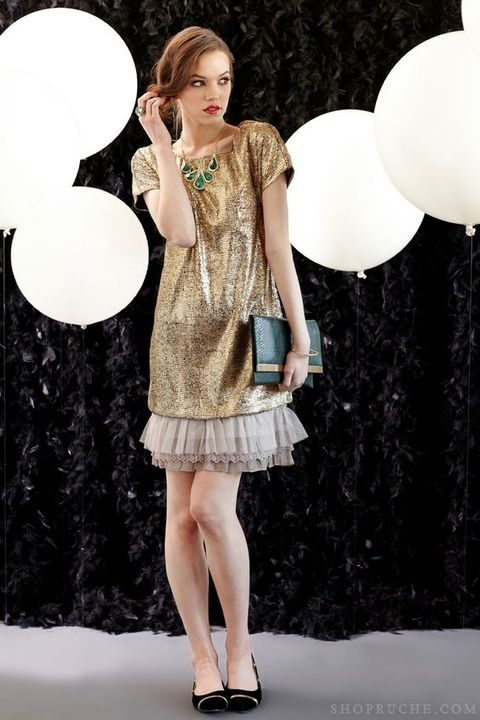 gold sequin 20s inspired dress with ruffles and a statement necklace