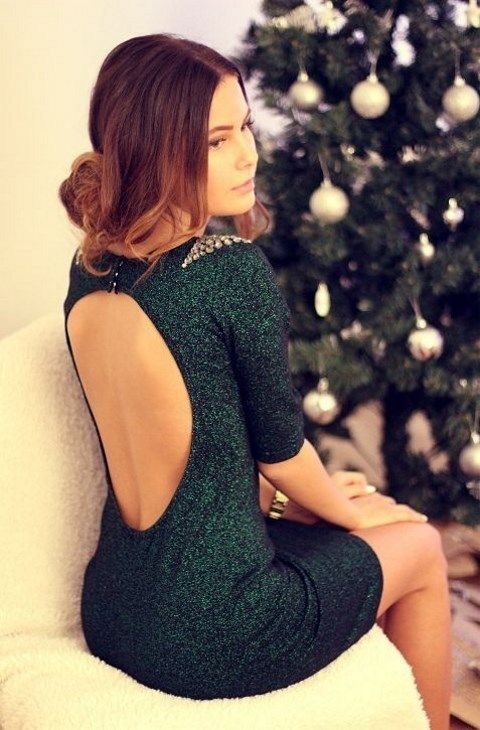 green glitter dress with a cutout back and embellished shoulders