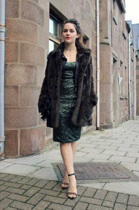 green sequin dress and a brown fur coat