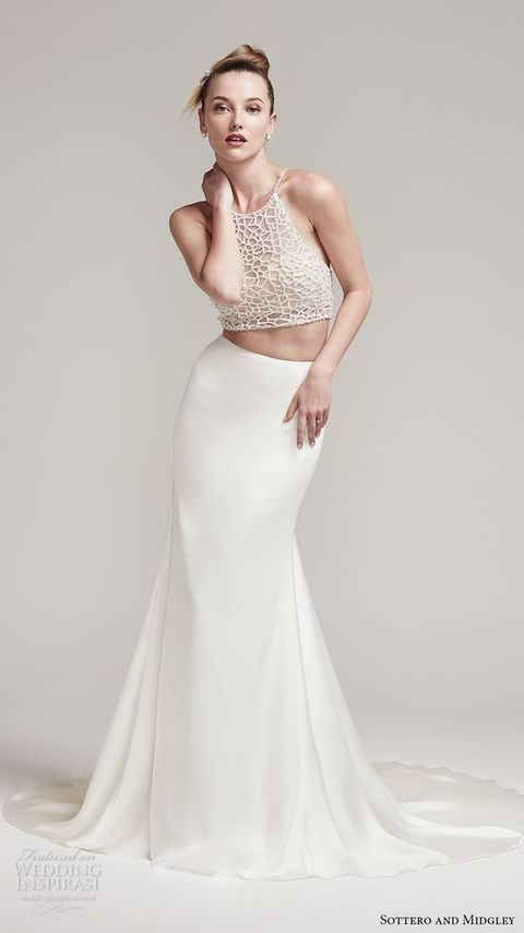 halter neckline beaded crop top and a plaind slim skirt with a train