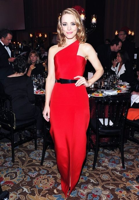 one shoulder red asymmetrical dress with a black belt