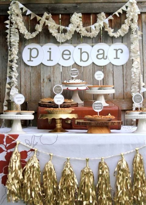 pie bar with different pies on cake stands