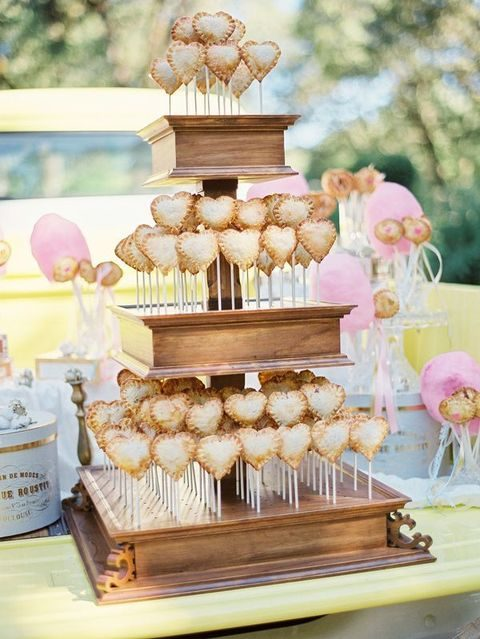 pie heart pops on a wooden box cake stand