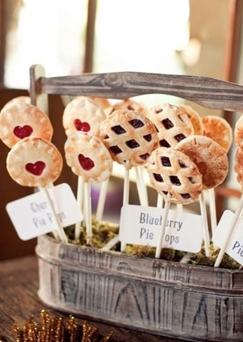 pie pops placed into a vintage box with moss