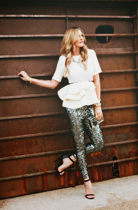 sequin trousers, a white peplum blouse with a thin belt and short sleeves