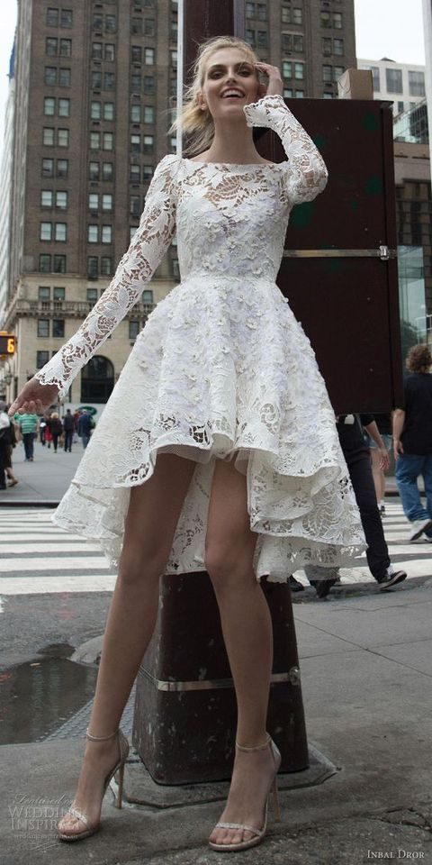 short high low wedding dress with a bateau neck and long sleeves