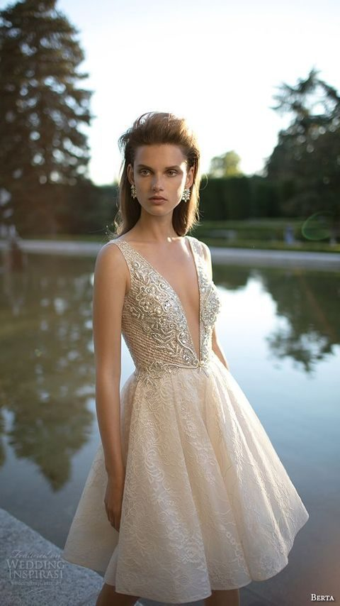 short sleeveless wedding dress with lace embroidery and beading