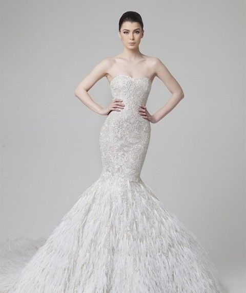 strapless beaded wedding dress with a feather tail
