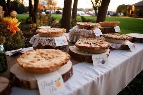 Beautiful Wedding Pie Table With Pies Displayed On Wood Slices
