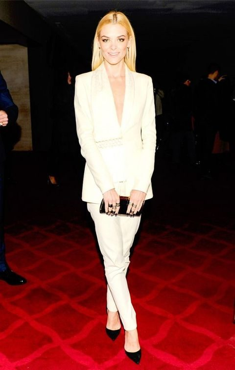 white pant suit with black and gold touches
