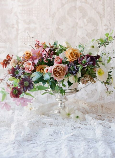 beautiful and lush arrangement for a wedding centerpiece