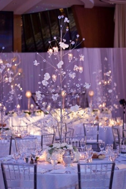 candle holders hanging on the centerpieces