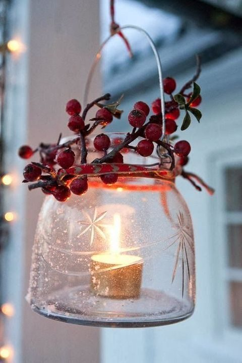 candle lanterns with berries