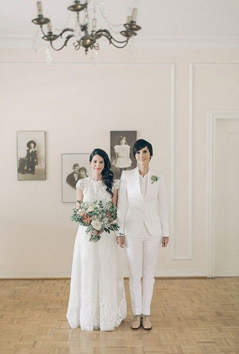 crispy white lace illusion neckline wedding dress and a white suit and a top