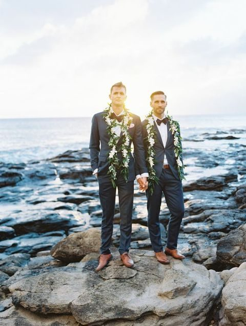 dark grey suits, white shirts, black bow ties and tan shoes for a couple look
