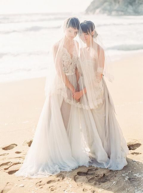 dove grey wedding dresses, one with a lace bodice, the second with a ruffled one