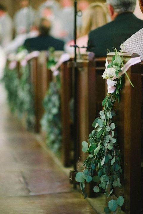 eucalyptus leaves, white roses, pink ribbon for a wedding aisle