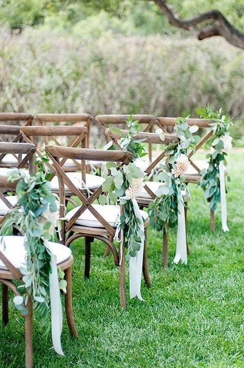 eucalyptus with cream ribbon for aisle chairs
