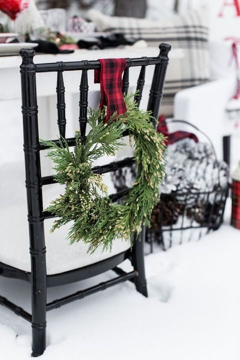 evergreen and plaid wreath to decorate venue chairs