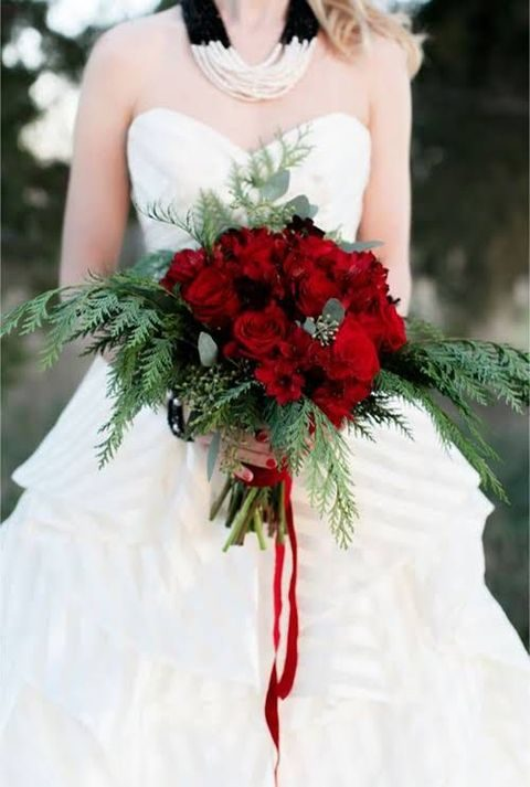 evergreen and red flowers wedding bouquet