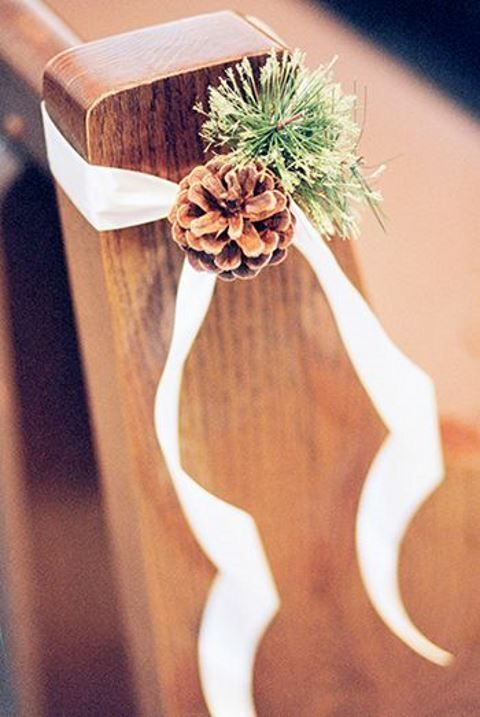 evergreen branches with pinecones and ribbon for wedding aisle decor