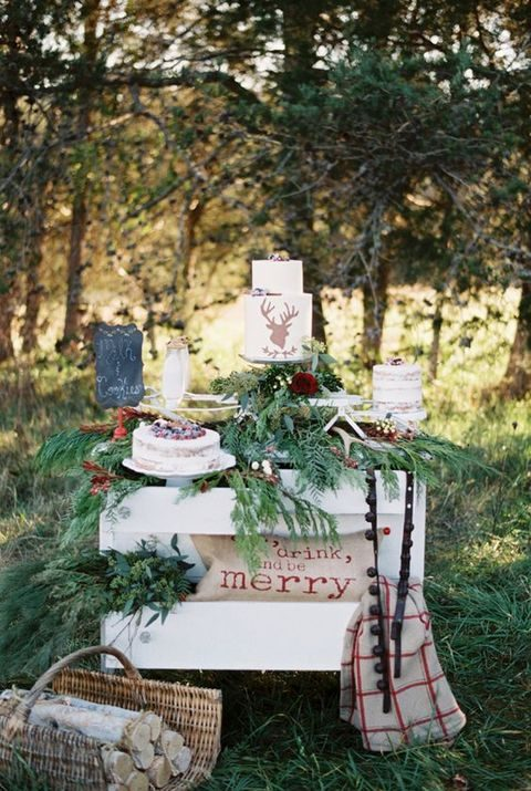 evergreen dessert table decor for a rustic wedding