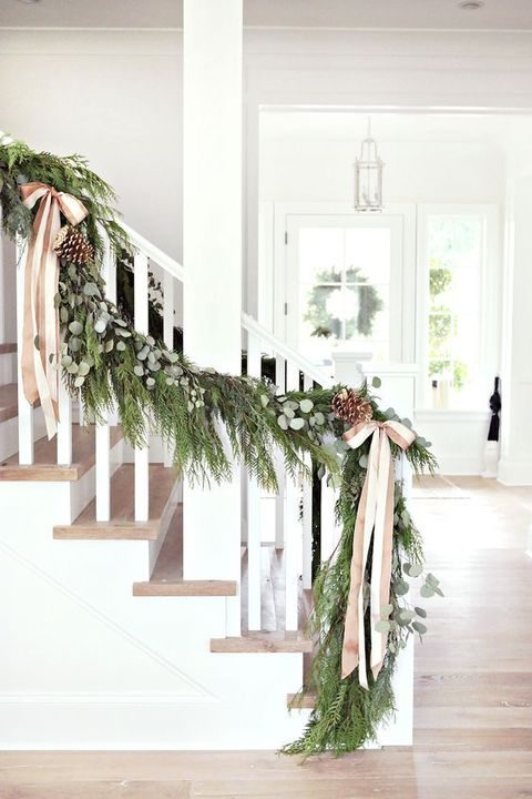 evergreen garland with pinecones and ribbon