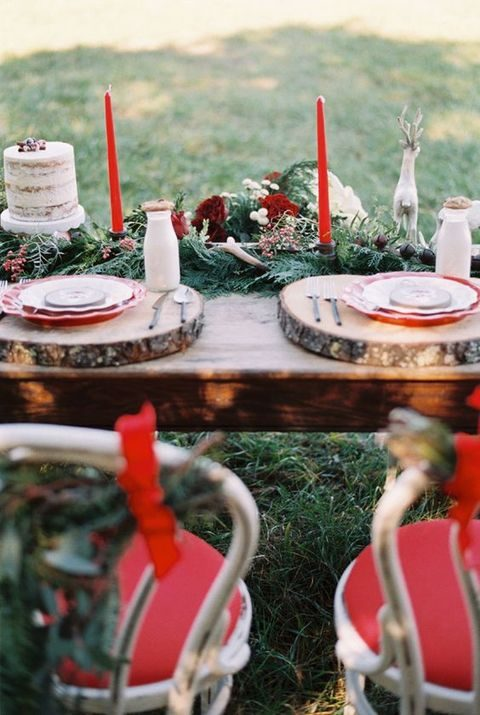 evergreen table runner with antlers and red candles