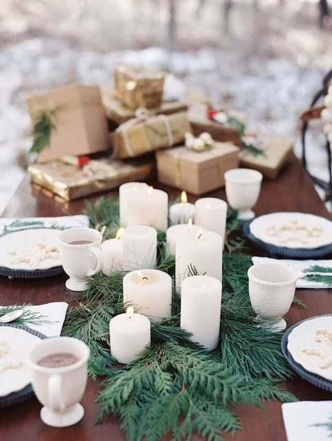 evergreen table runner with pillar candles