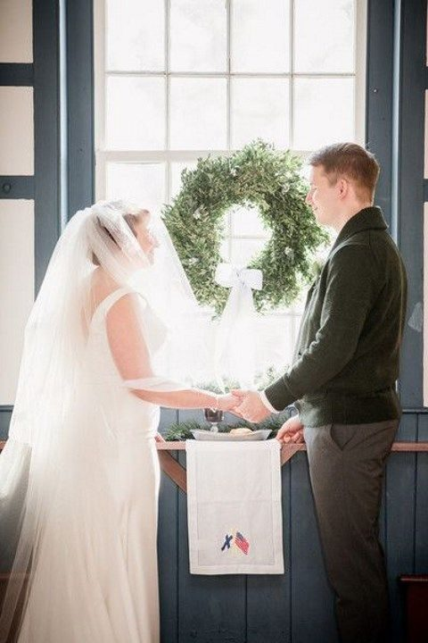 evergreen winter wedding wreath at the altar