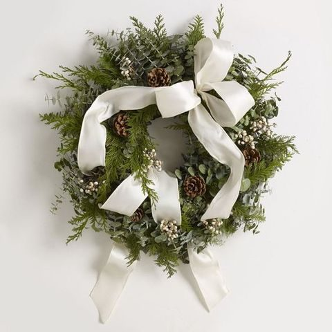 evergreen winter wedding wreath with pinecones, eucalyptus and white ribbon