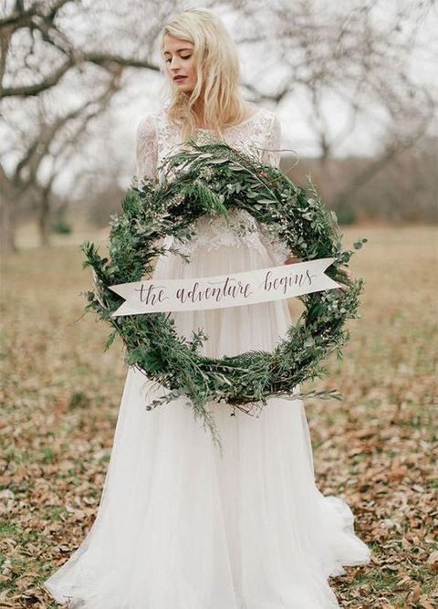 evergreen wreath with a sign