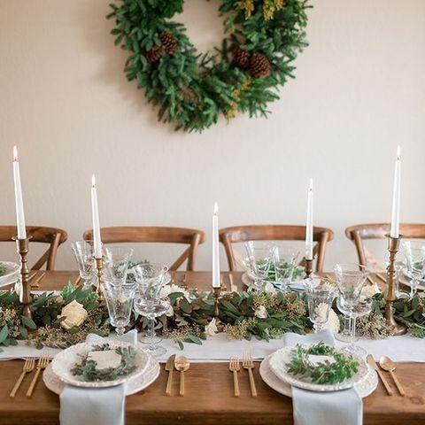 evergreen wreath with pinecones for wedding decor