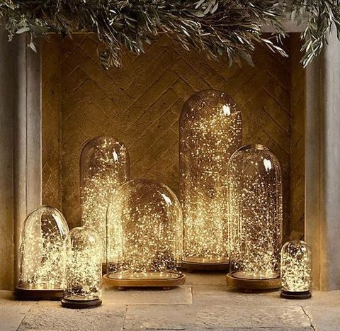 fairy lights inside cloches for holiday decor