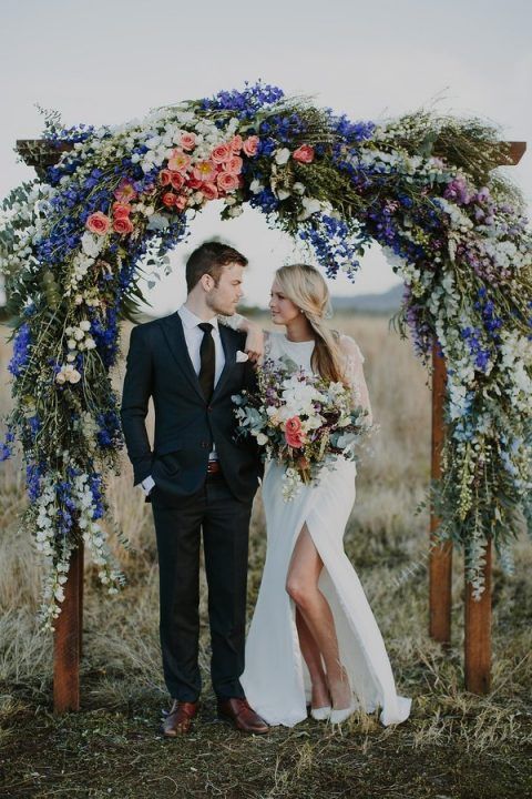 fantastic bold floral arch with blue and peach touches