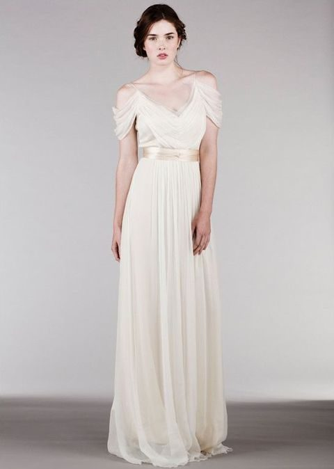 flowy light wedding dress with a beige sash and a v-neck