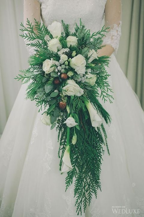 giant cascading white bouquet with evergreen branches