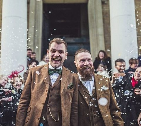 grooms in same stylish tweed suits