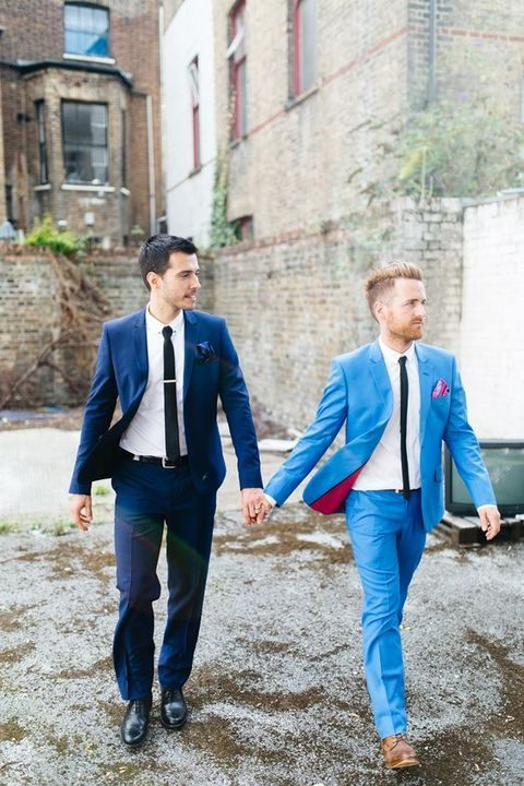 grooms in suits of various shades of blue