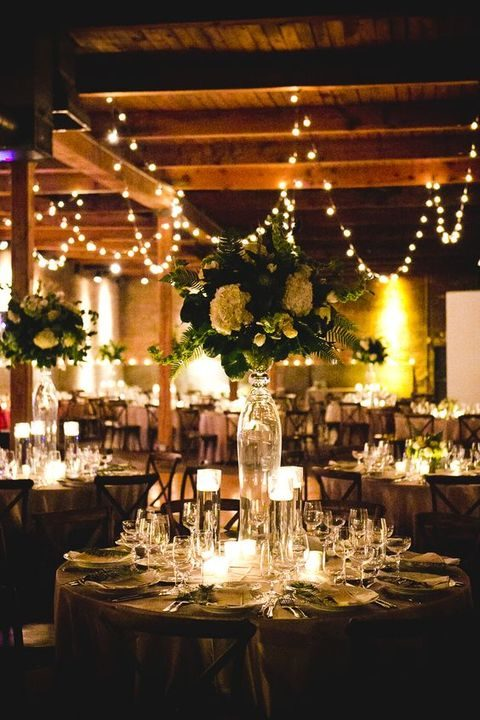 hanging lights and floating lanterns on the tables