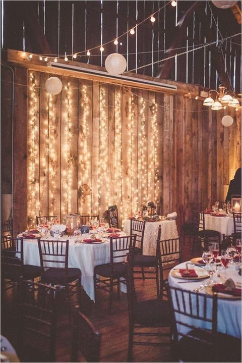 hanging lights and paper lanterns for a winter barn wedding