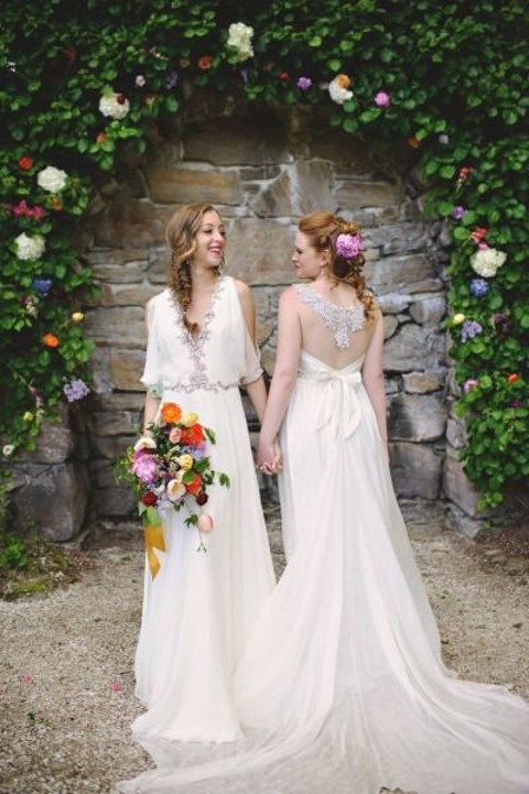 ivory wedding dresses with silver embellishments and a bow on the back