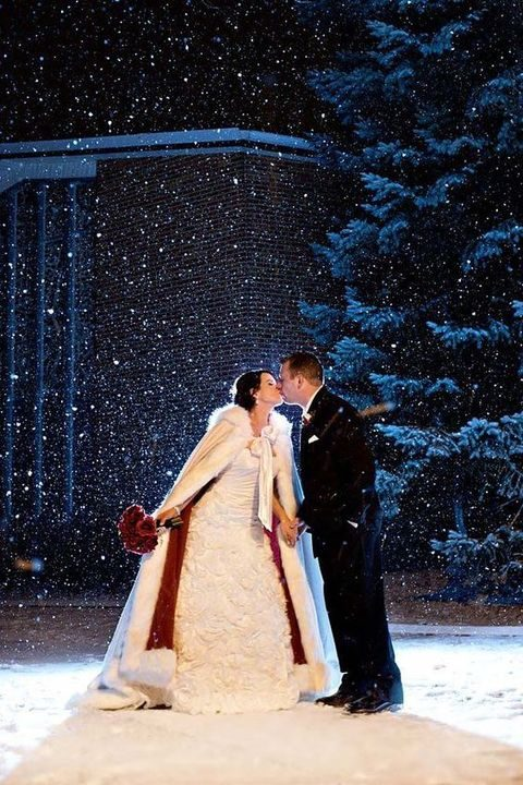 kissing in the snow, at night