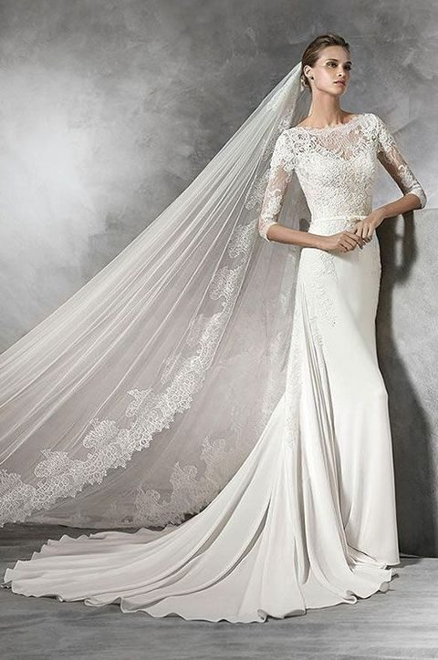 lace bodice, sleeves and a bateau neckline by Pronovias